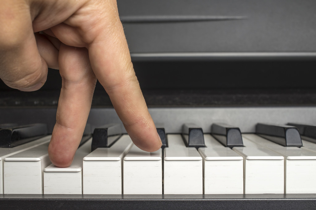 fingers click on the piano keys as if the legs are walking