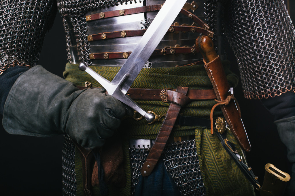 Sword in hand. Military clothing of the past